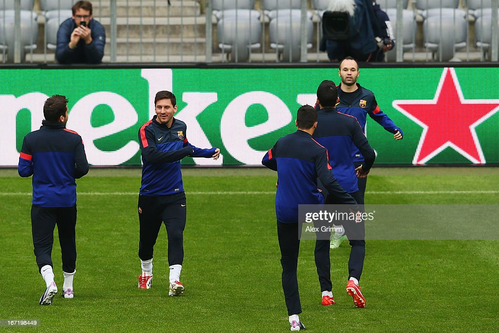 <a gi-track='captionPersonalityLinkClicked' href=/galleries/search?phrase=Lionel+Messi&family=editorial&specificpeople=453305 ng-click='$event.stopPropagation()'>Lionel Messi</a> (2L) and team mates exercise during a FC Barcelona press conference ahead of their UEFA Champions League Semi Final first leg match against FC Bayern Muenchen on April 22, 2013 in Munich, Germany.