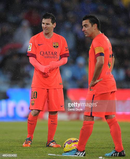 Lionel Messi and Xavi Hernandez line up a free kick during the La Liga match between Getafe CF and FC Barcelona at the Alfonso Perez stadium on...