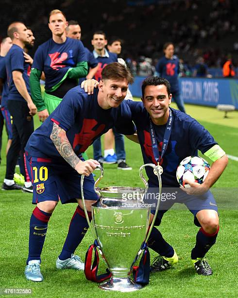 Lionel Messi and Xavi Hernandez of Barcelona celebrate with the trophy after the UEFA Champions League Final between Juventus and FC Barcelona at...