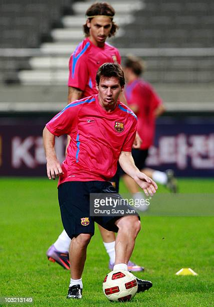 Lionel Messi and Zlatan Ibrahimovic of FC Barcelona attend a training session at the Seoul Worldcup stadium on August 3 2010 in Seoul South Korea FC...