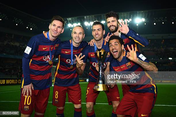 Lionel Messi Andres Iniesta Sergio Busquets Gerard Pique and Dani Alves of Barcelona celebrate with the trophy following their team's 30 victory...