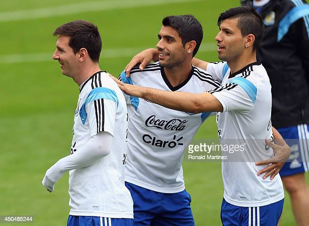 Lionel Messi Augusto Fernandez and Sergio Aguero of Argentina during a training session on June 12 2014 in Vespasiano Brazil