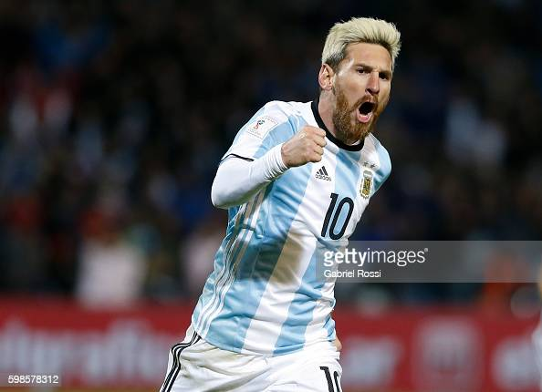 Lionel Messi celebrates after scoring the first goal during a match between Argentina and Uruguay as part of FIFA 2018 World Cup Qualifiers at...