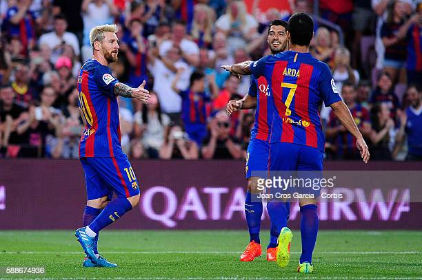Lionel Messi celebrates scoring with Luis Suárez and Arda Turan celebrating the Messi goal during the Joan Gamper Trophy match between FCBarcelona vs...