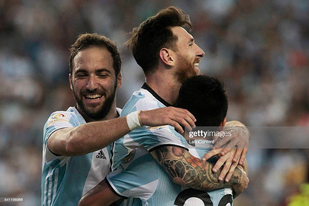 Lionel Messi celebrates with teammates Gonzalo Higuain and Nicolas Gaitan after scoring the third goal of the game during a Quarterfinal match...