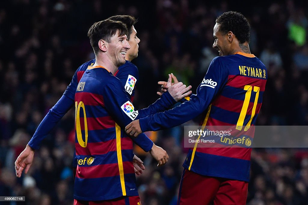 Lionel Messi (L) FC Barcelona celebrates with his teammate Neymar of FC Barcelona after scoring his team's fourth goal during the La Liga match between FC Barcelona and Real Sociedad de Futbol at Camp Nou on November 28, 2015 in Barcelona, Spain.