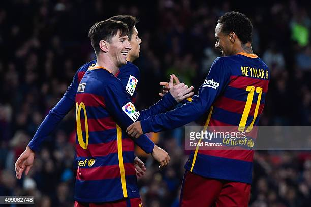 Lionel Messi FC Barcelona celebrates with his teammate Neymar of FC Barcelona after scoring his team's fourth goal during the La Liga match between...