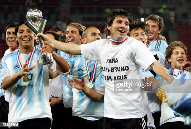 Lionel Messi from Argentina celebrates with the cup after winning the FIFA World Youth Championships 2005 Final between Argentina and Nigeria on July...