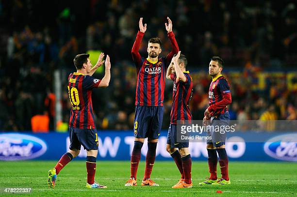 Lionel Messi Gerard Pique Andres Iniesta and Jordi Alba of Barcelona celebrate their team's 21 victory during the UEFA Champions League Round of 16...