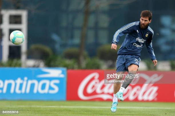 Lionel Messi kicks the ball during a training session at 'Julio Humberto Grondona' training camp on August 29 2017 in Ezeiza Argentina