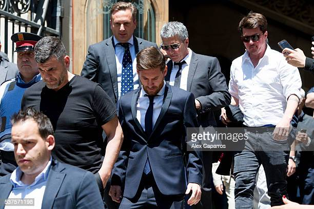 Lionel Messi leaves the courthouse followed by his father Jorge Horacio Messi and his brother Rodrigo Messi on June 2 2016 in Barcelona Spain Lionel...