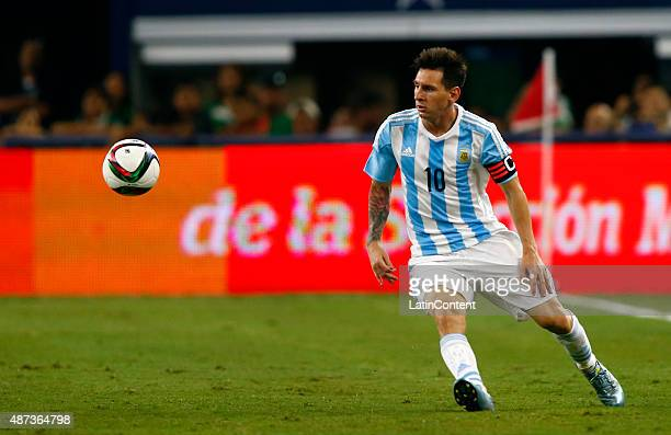 Lionel Messi looks at the ball during the international friendly match between Argentina and Mexico at ATT Stadium on September 08 2015 in Arlington...