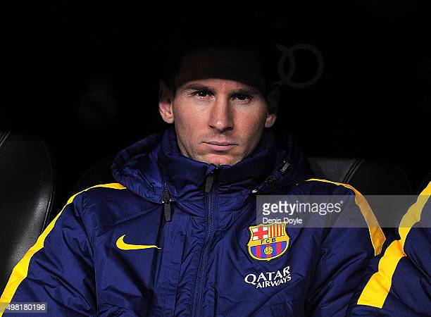 Lionel Messi looks out from the substitutes bench during the La Liga match between Real Madrid and Barcelona at Estadio Santiago Bernabeu on November...