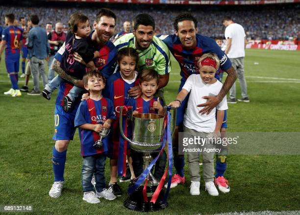 Lionel Messi Luis Suarez and Neymar JR of Barcelona and their kids pose for a photo as they celebrate with the trophy after the Copa Del Rey Final...