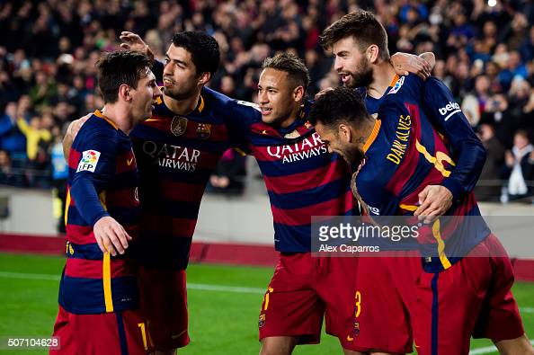 Lionel Messi Luis Suarez Neymar Santos Jr and Dani Alves of FC Barcelona celebrate with their teammate Gerard Pique after he scored his team's second...