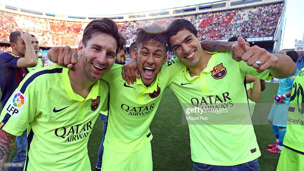Lionel Messi, Neymar and Luis Suarez of FC Barcelona celebrate winning the La Liga title after the La Liga match between Club Atletico de Madrid and FC Barcelona at Vicente Calderon Stadium on May 17, 2015 in Madrid, Spain.