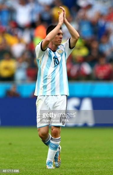 Lionel Messi of Argentina acknowledges the fans as he walks off the pitch after being replaced during the 2014 FIFA World Cup Brazil Group F match...
