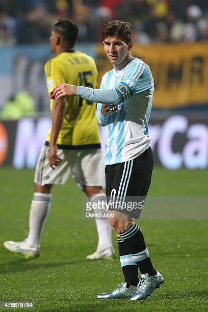 Lionel Messi of Argentina adjusts his captains armband during the 2015 Copa America Chile quarter final match between Argentina and Colombia at...
