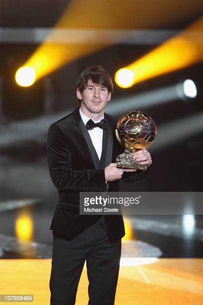 Lionel Messi of Argentina and Barcelona FC receives the men's player of the year award during the FIFA Ballon d'or Gala at the Zurich Kongresshaus on...