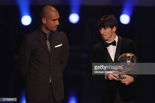 Lionel Messi of Argentina and Barcelona FC receives the men's player of the year award from his club coach Pep Guardiola during the FIFA Ballon d'or...
