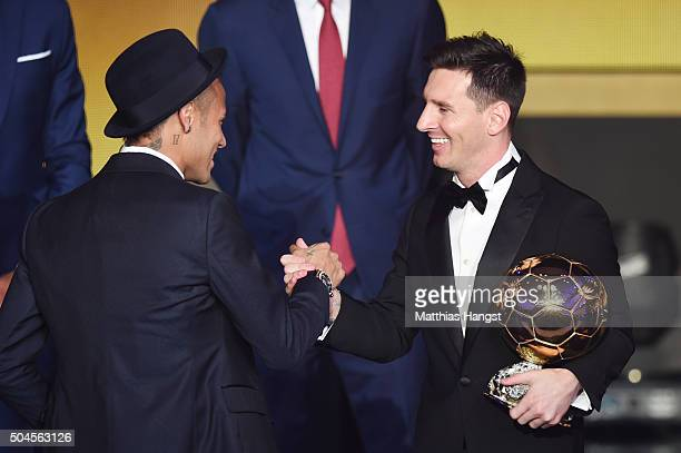 Lionel Messi of Argentina and FC Barcelona the winner of the Ballon d'or is congratulated by Neymar Jr of Brazil and FC Barcelona during the FIFA...