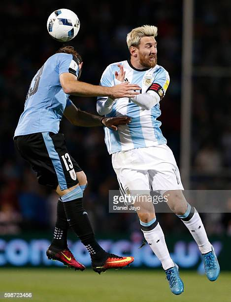 Lionel Messi of Argentina and Gaston Silva of Uruguay jump for the ball during a match between Argentina and Uruguay as part of FIFA 2018 World Cup...