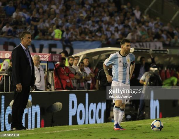 Lionel Messi of Argentina and manager of Argentina national football team Edgardo Bauza are seen during the FIFA 2018 World Cup Qualifiers football...