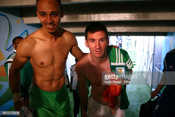 Lionel Messi of Argentina and Peter Odemwingie of Nigeria walk in the tunnel after the 2014 FIFA World Cup Brazil Group F match between Nigeria and...