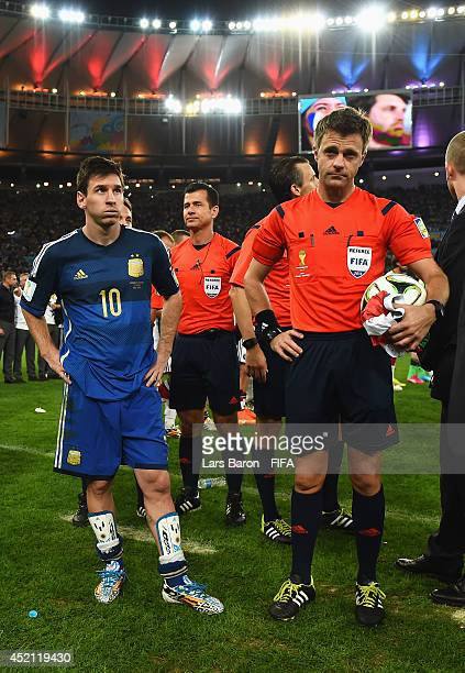 Lionel Messi of Argentina and referee Nicola Rizzoli are seen before the award ceremony of the 2014 FIFA World Cup Brazil Final match between Germany...