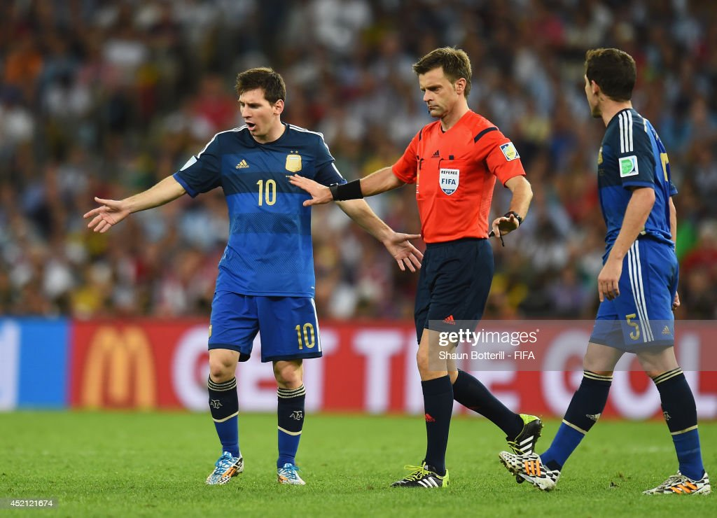 Lionel Messi of Argentina appeals to referee Nicola Rizzoli during the 2014 FIFA World Cup Brazil Final match between Germany and Argentina at Maracana on July 13, 2014 in Rio de Janeiro, Brazil.