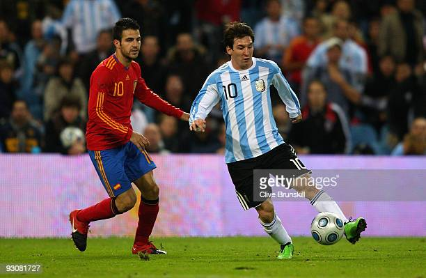 Lionel Messi of Argentina attempts to move away from Cesc Fabregas of Spain during the friendly International football match Spain against Argentina...