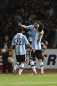 Lionel Messi of Argentina celebrates a goal during a match between Argentina and Paraguay as part of the South American Qualifiers for the FIFA...