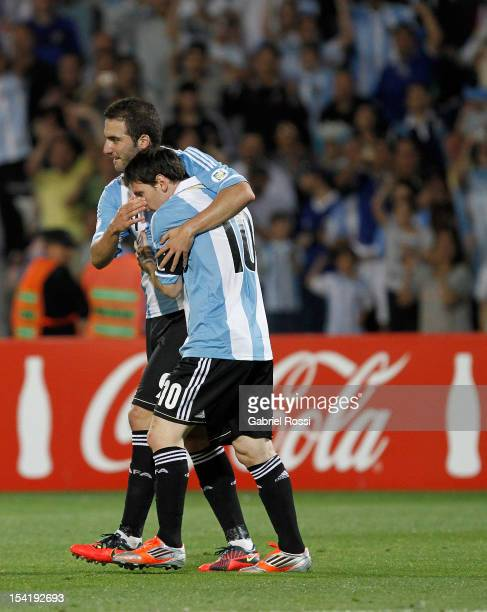Lionel Messi of Argentina celebrates a goal during a match between Argentina and Uruguay as part of the South American Qualifiers for the FIFA Brazil...