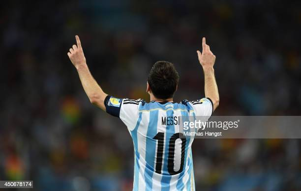 Lionel Messi of Argentina celebrates after scoring his team's second goal during the 2014 FIFA World Cup Brazil Group F match between Argentina and...