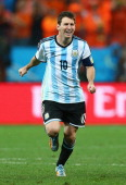 Lionel Messi of Argentina celebrates defeating the Netherlands in a shootout during the 2014 FIFA World Cup Brazil Semi Final match between the...