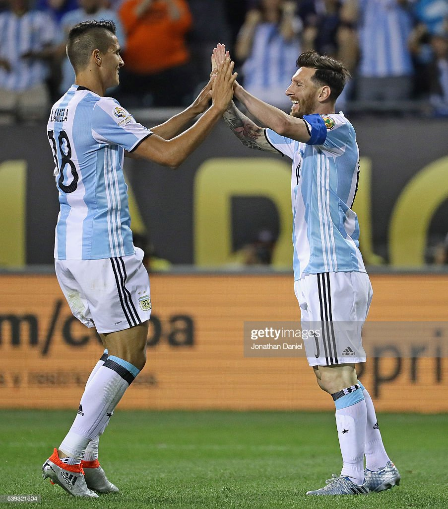 <a gi-track='captionPersonalityLinkClicked' href=/galleries/search?phrase=Lionel+Messi&family=editorial&specificpeople=453305 ng-click='$event.stopPropagation()'>Lionel Messi</a> #10 of Argentina (R) celebrates his first goal of the match with teammate <a gi-track='captionPersonalityLinkClicked' href=/galleries/search?phrase=Erik+Lamela&family=editorial&specificpeople=7198648 ng-click='$event.stopPropagation()'>Erik Lamela</a> #18 against Panama during a match in the 2016 Copa America Centenario at Soldier Field on June 10, 2016 in Chicago, Illinois. Argentina defeated Panama 5-0.