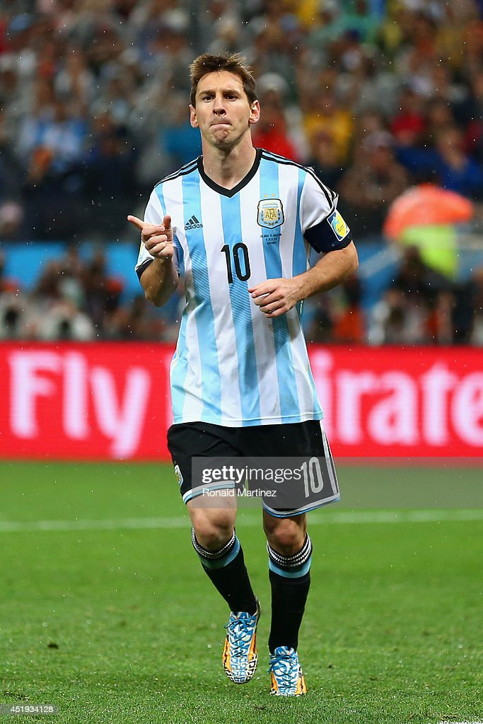 Lionel Messi of Argentina celebrates scoring a goal during a penalty shootout during the 2014 FIFA World Cup Brazil Semi Final match between the...
