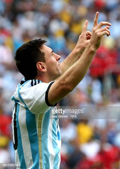 Lionel Messi of Argentina celebrates scoring his team's first goal during the 2014 FIFA World Cup Brazil Group F match between Nigeria and Argentina...