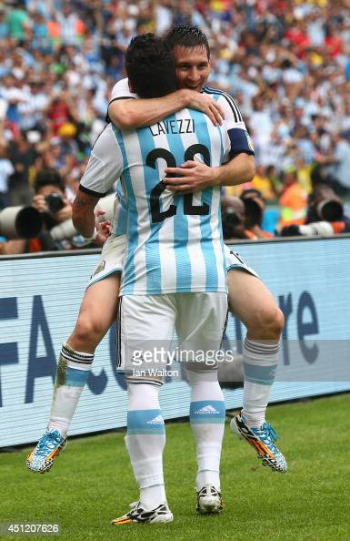 Lionel Messi of Argentina celebrates scoring his team's second goal and his second of the game with Ezequiel Lavezzi during the 2014 FIFA World Cup...