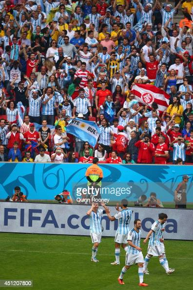 Lionel Messi of Argentina celebrates scoring his team's second goal and his second of the game with teammates during the 2014 FIFA World Cup Brazil...