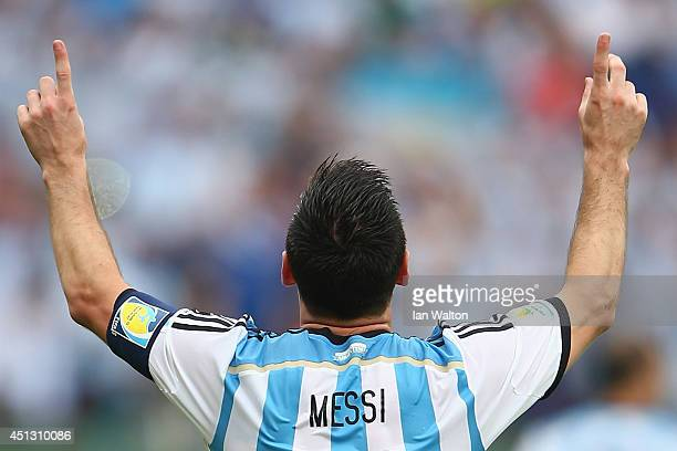 Lionel Messi of Argentina celebrates scoring his team's second goal and his second of the game during the 2014 FIFA World Cup Brazil Group F match...