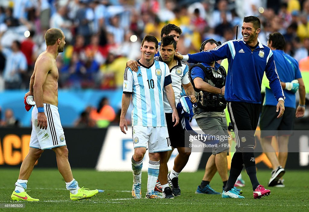 <a gi-track='captionPersonalityLinkClicked' href=/galleries/search?phrase=Lionel+Messi&family=editorial&specificpeople=453305 ng-click='$event.stopPropagation()'>Lionel Messi</a> (2nd L) of Argentina celebrates the 1-0 win with his teammates Pablo Zabaleta (1st L), <a gi-track='captionPersonalityLinkClicked' href=/galleries/search?phrase=Sergio+Aguero&family=editorial&specificpeople=1100704 ng-click='$event.stopPropagation()'>Sergio Aguero</a> (3rd L) and <a gi-track='captionPersonalityLinkClicked' href=/galleries/search?phrase=Mariano+Andujar&family=editorial&specificpeople=804546 ng-click='$event.stopPropagation()'>Mariano Andujar</a> (1st R) of Argentina during the 2014 FIFA World Cup Brazil Round of 16 match between Argentina and Switzerland at Arena de Sao Paulo on July 1, 2014 in Sao Paulo, Brazil.