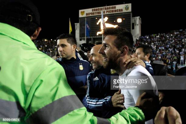 Lionel Messi of Argentina celebrates with coach Jorge Sampaoli after winning a match between Ecuador and Argentina as part of FIFA 2018 World Cup...