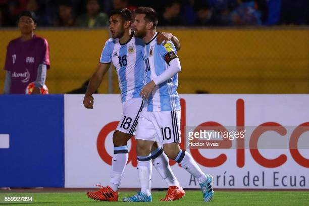 Lionel Messi of Argentina celebrates with teammate Eduardo Salvio after scoring the second goal of his team during a match between Ecuador and...