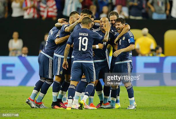 Lionel Messi of Argentina celebrates with teammates after scoring a goal on a free kick in the first half against the United States during a 2016...