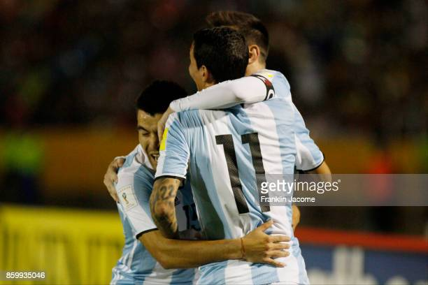 Lionel Messi of Argentina celebrates with teammates Angel Di Maria and Marcos Acuña after scoring the second goal of his team during a match between...