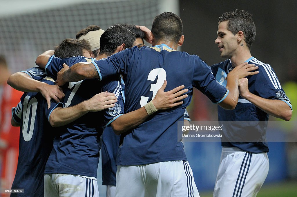 Lionel Messi of Argentina celebrates with teammates his team's second goal during the international friendly match between Germany and Argentina and Commerzbank-Arena on August 15, 2012 in Frankfurt am Main, Germany.