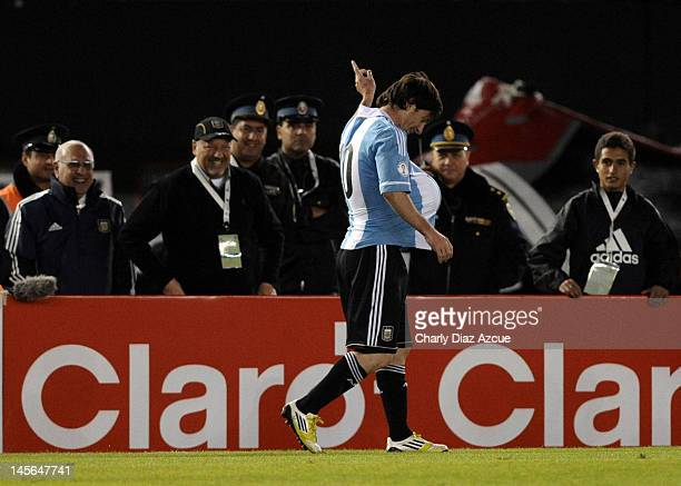Lionel Messi of Argentina celebrates with the ball under his jersey as there are rumors that his girlfriend Antonella Rocuzzo is pregnant during a...