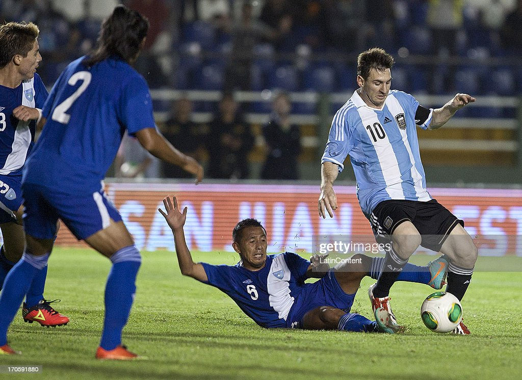<a gi-track='captionPersonalityLinkClicked' href=/galleries/search?phrase=Lionel+Messi&family=editorial&specificpeople=453305 ng-click='$event.stopPropagation()'>Lionel Messi</a> of Argentina competes for the ball with Milton Leal of Guatemala during a friendly soccer match between Argentina and Guatemala at Mateo Flores stadium on June 14 in Guatemala City, Guatemala.