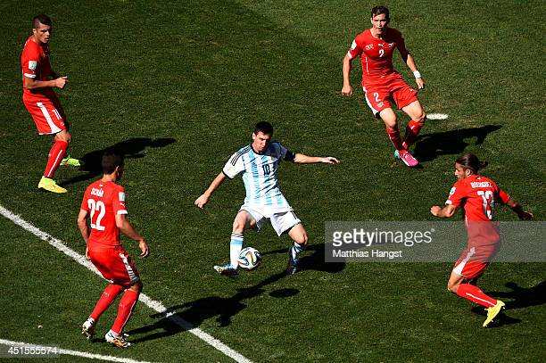 Lionel Messi of Argentina controls the ball against Josip Drmic Fabian Schar Stephan Lichtsteiner and Ricardo Rodriguez of Switzerland during the...